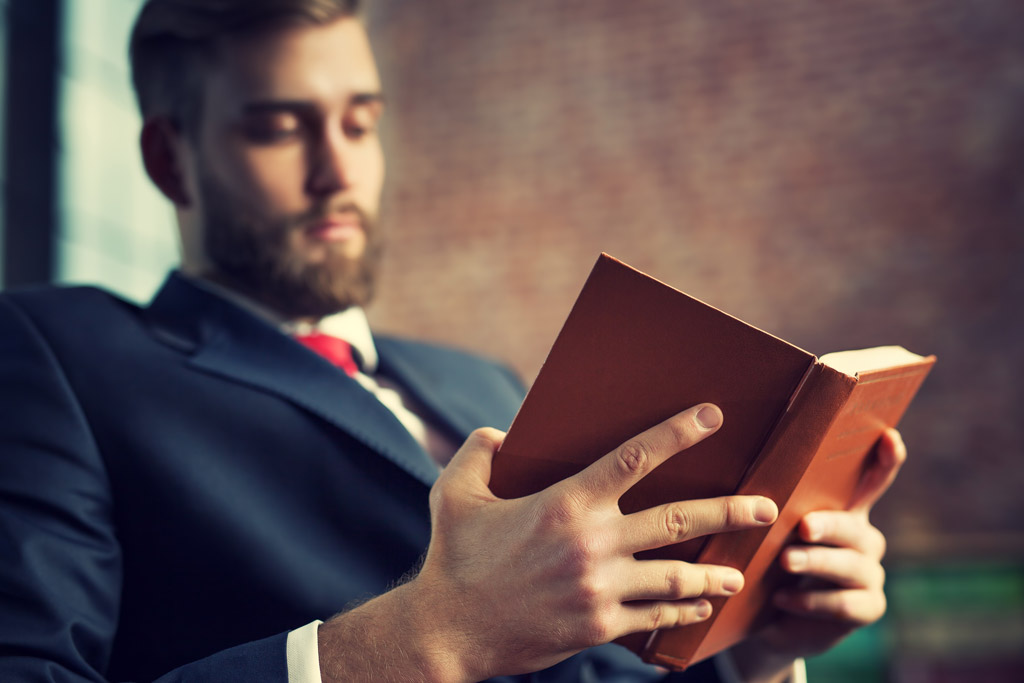Business-Man-Reading-Book