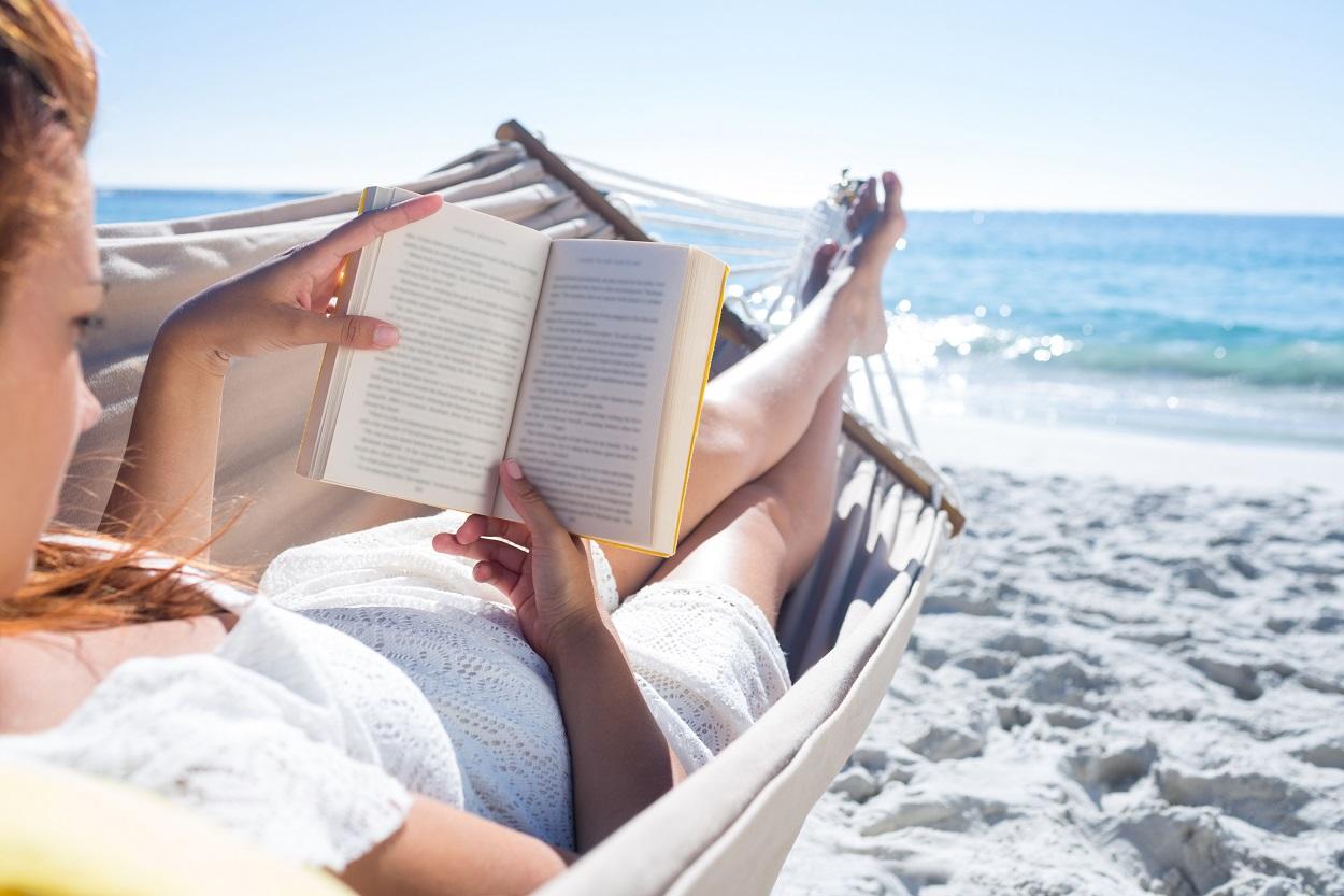 Reading book in hammock